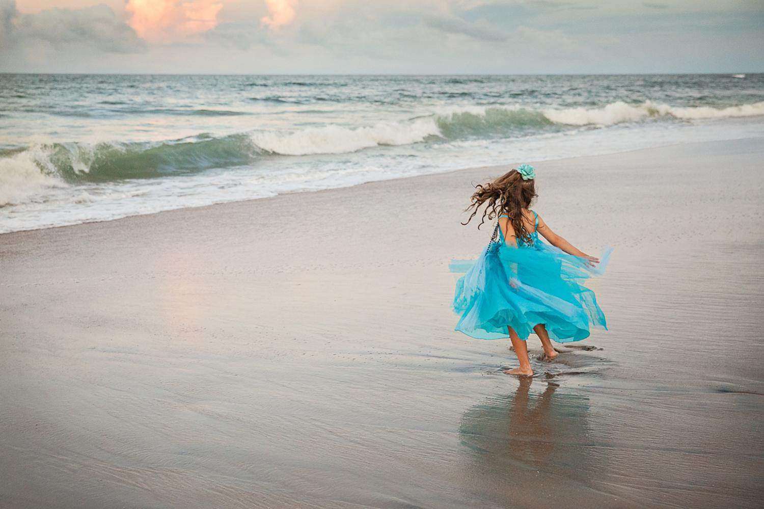 Outer Banks photograph of Little girl twirling photograph in Nags Head NC